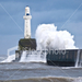 ist2 5055479-waves-crashing-on-breakwater-with-lighthouse-in-abe